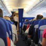 How to Sleep in the Aisle Seat on a Plane (4 Tips)