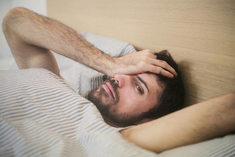 Tired Man Lying Awake in Bed