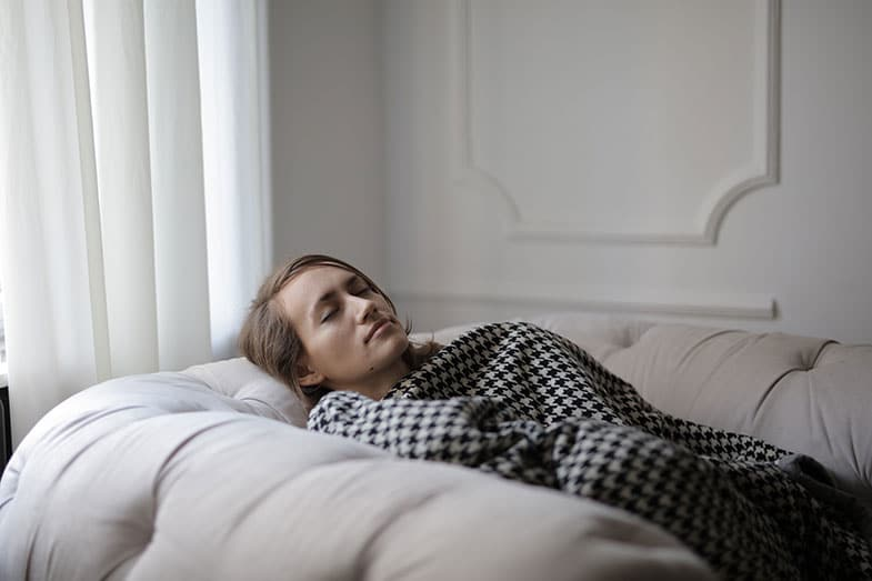 Woman Sleeping on the Couch With a Blanket