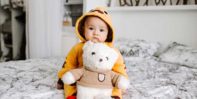 A Baby with Hooded Pajamas