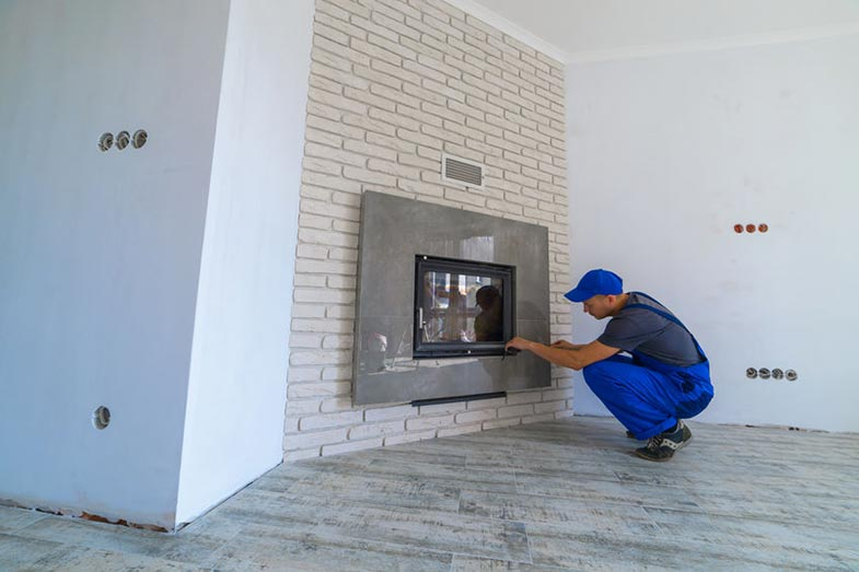 Installing Fireplace in White Brick Wall