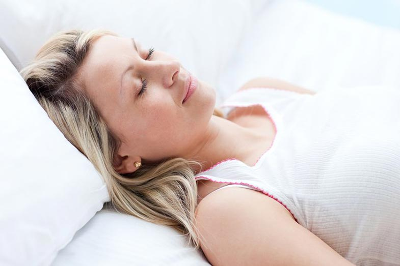 Woman Sleeping on Back With White Shirt