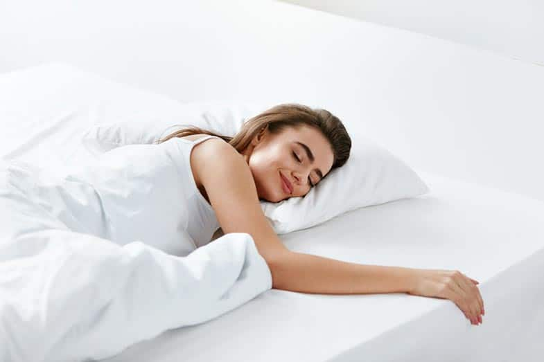Woman Sleeping on White Bed Sheets