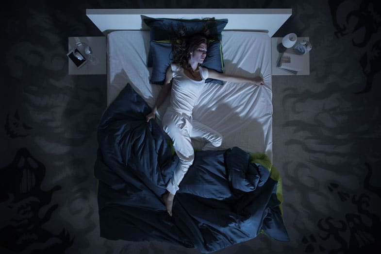 Woman Lying in Bed Having a Nightmare