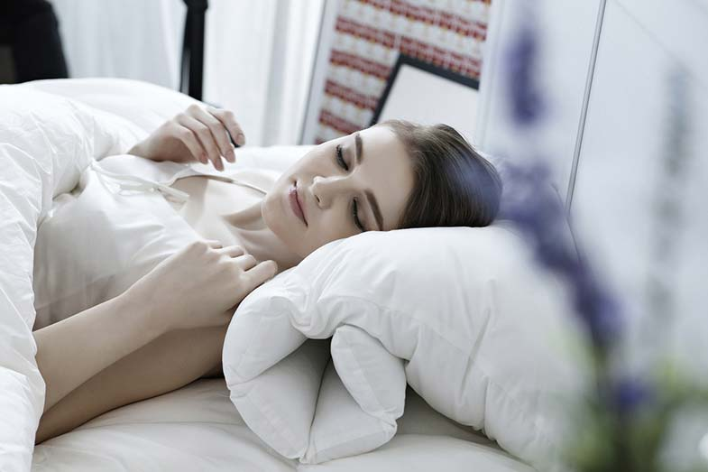 Girl Sleeping in Bed Beside Plant