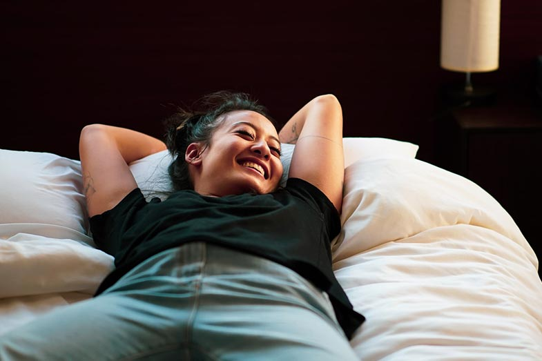 Woman Laughing in Her Sleep