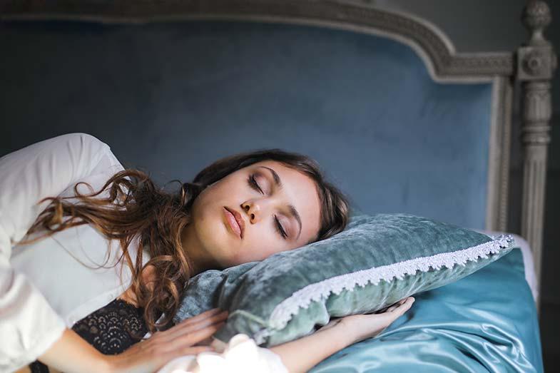 Woman Sleeping on Blue Pillow