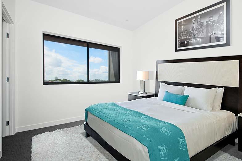 Large White Bed on Black Frame