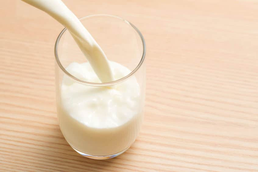 Pouring Cold Milk Into a Glass