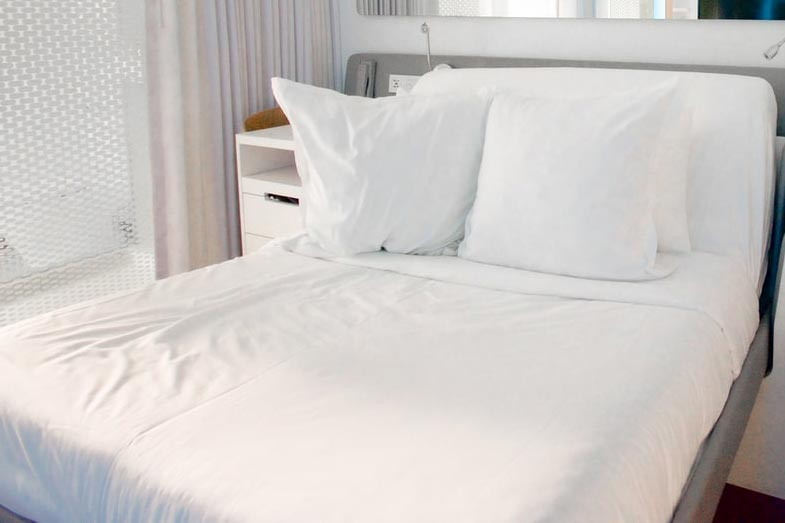 White Sheets Mattress Bed