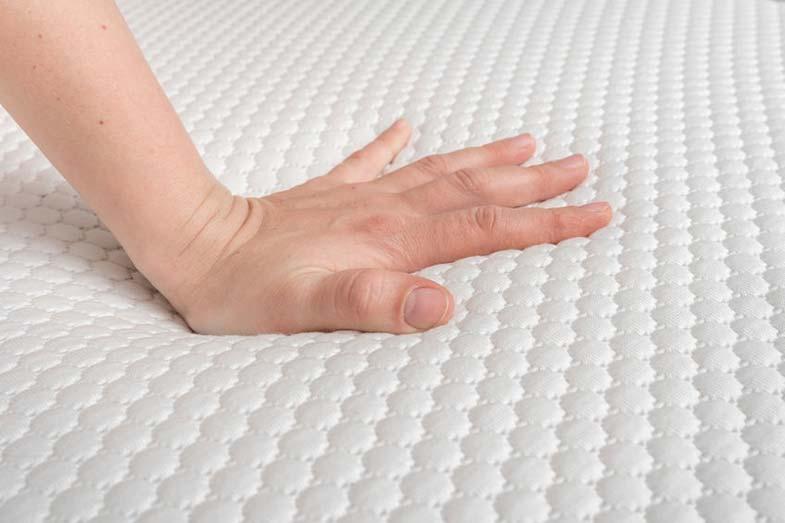 Hand on Memory Foam Mattress