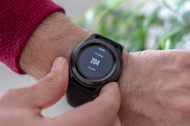 Man Wearing Round Black Smartwatch