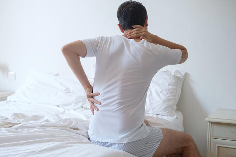 Man With Back Pain in Bed After Sleeping