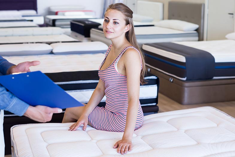 Mattress Seller Talking With Woman in Store