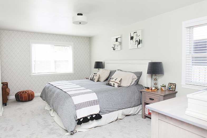 Large Bed with Gray Comforter