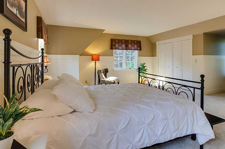 Large Bed with White Pillows and Sheets