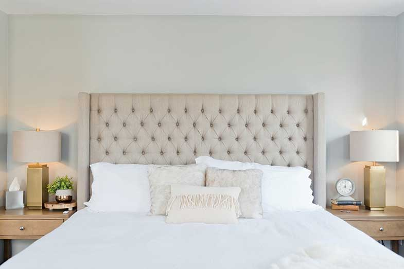 Large White Bed with Pillows and Headboard