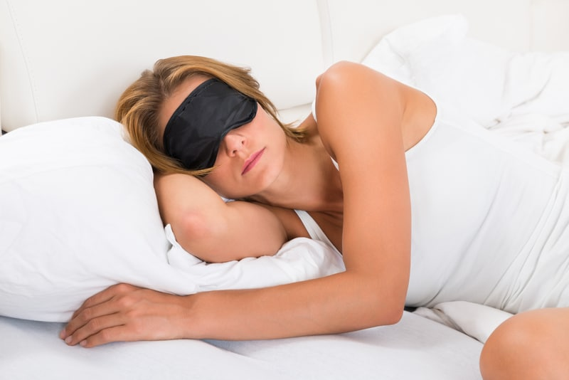 Woman Sleeping with Mask in Bed