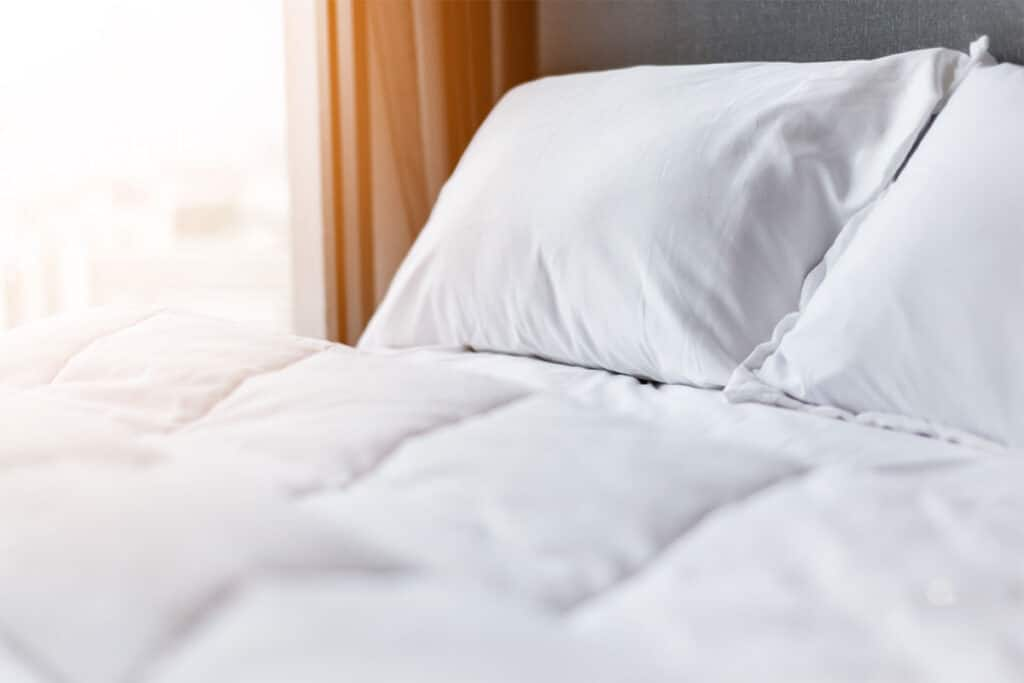 Bed With Clean, White Pillows and Sheets