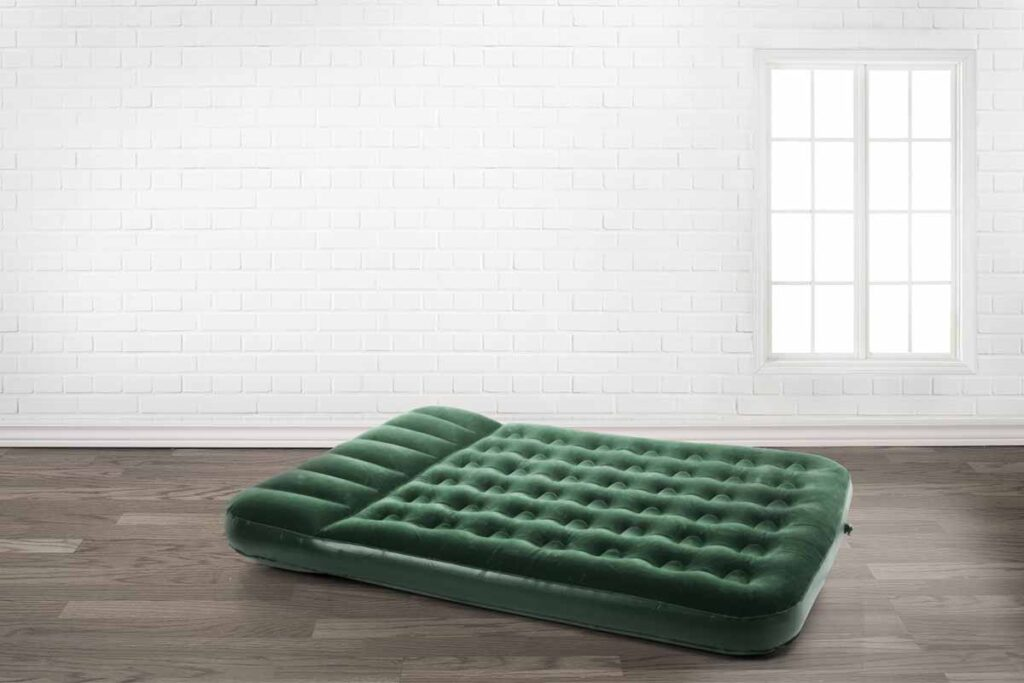 Green Air Bed in Empty Room