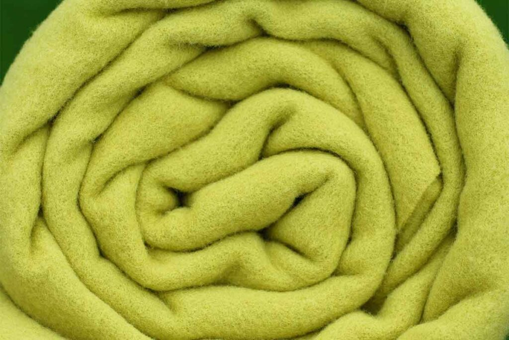 Rolled Up Greenish-Yellow Blanket